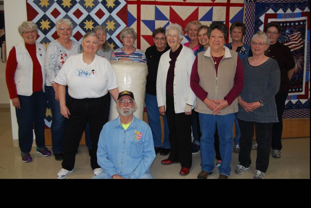 Dennis And Lynn (front) And The Quilting Cowpokes of Cheyenne (image)