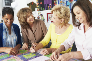Group Of Women Discussing Quilt Batting (image)
